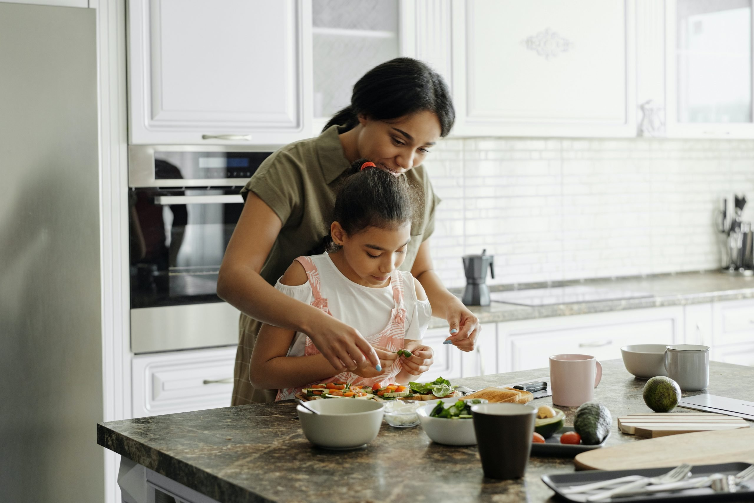 Mother Daughter Cookng in Kitchen